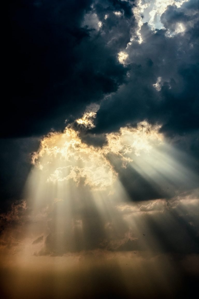 sun shines through clouds